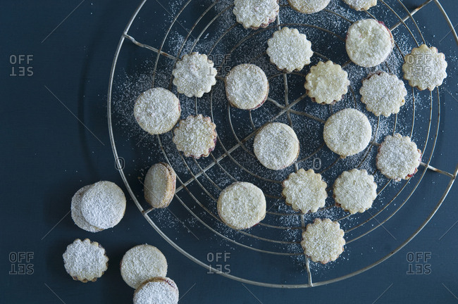 Christmas Cookies Spitzbuben on a baking grid- icing sugar