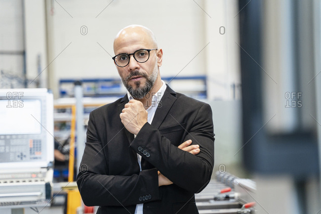 Portrait of serious businessman in a factory