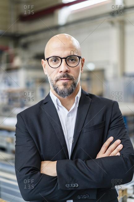 Portrait of confident businessman in factory