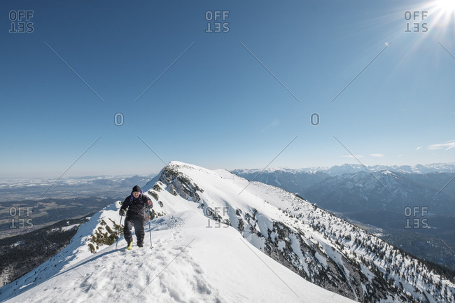 Germany- Bavaria- Gamsknogel- Weissbach- Chiemgau- senior man hiking in winter landscape
