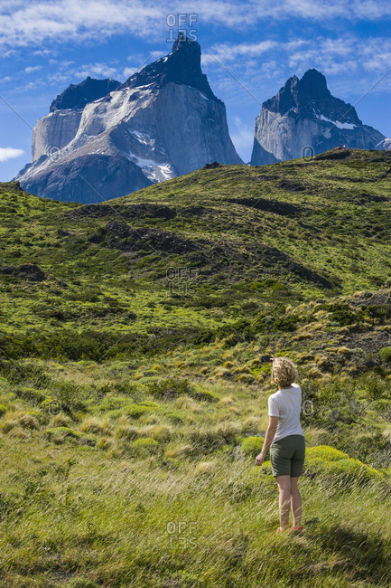 Chile- Patagonia- woman standing on meadow in Torres del Paine National Park