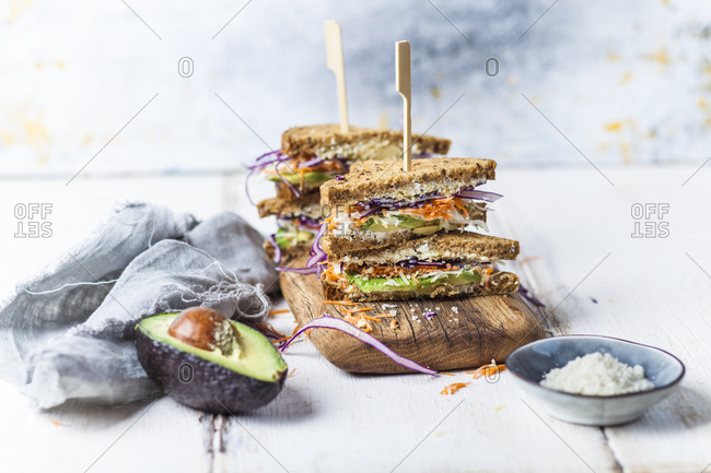 Veggie Sandwich- whole meal toast bread with grated carrot- red cabbage- white cabbage- avocado and cheese