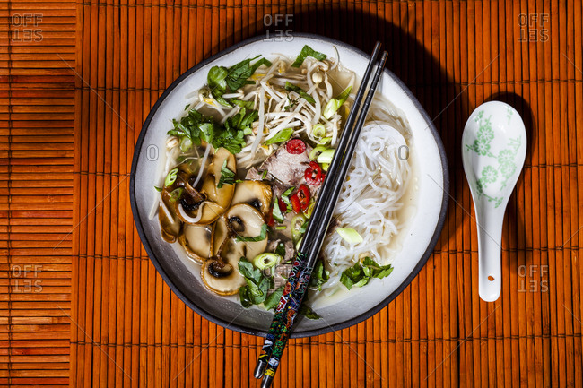 Vietnamese rice noodle soup with mushrooms and beef