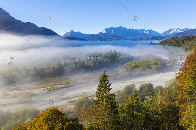 Germany- Upper Bavaria- Aerial view of Upper Isar Valley with fog- Wetterstein mountains in the background