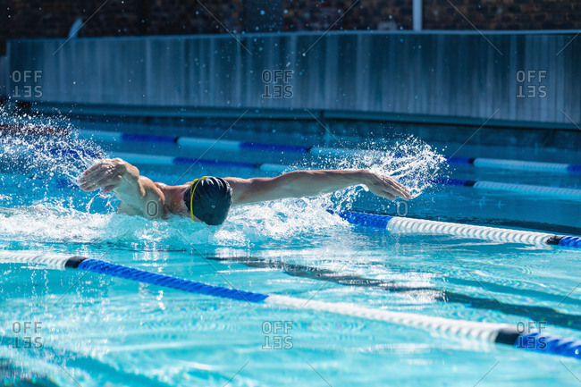 Male swimming freestyle in swimming pool