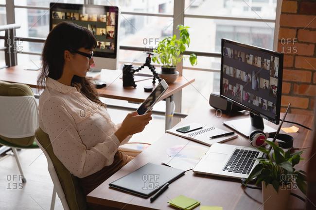 Businesswoman using digital tablet in office