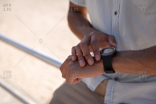 Man using smart watch at beach
