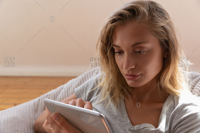 Young beautiful woman using digital tablet at home