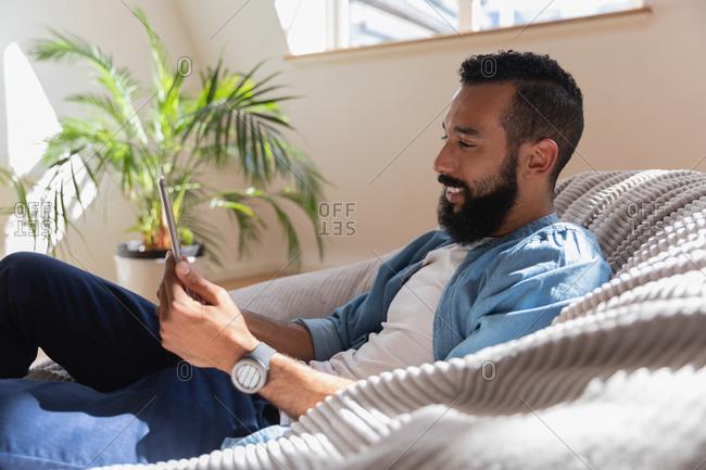 Man using digital tablet at home