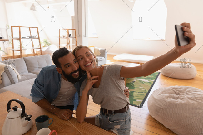Couple taking selfie at home
