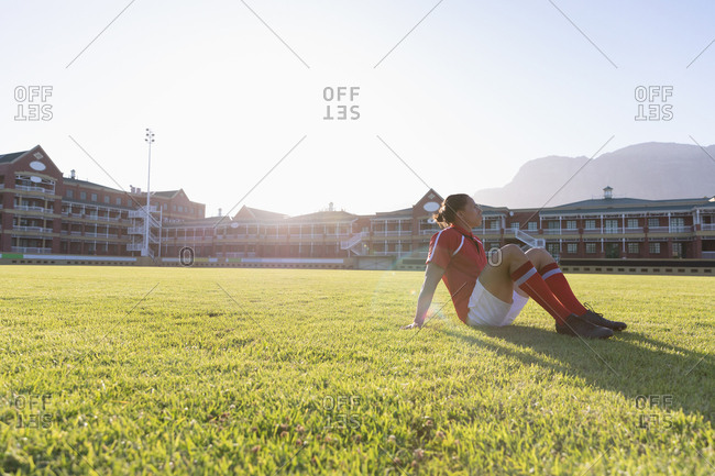 Male rugby player sitting on the ground