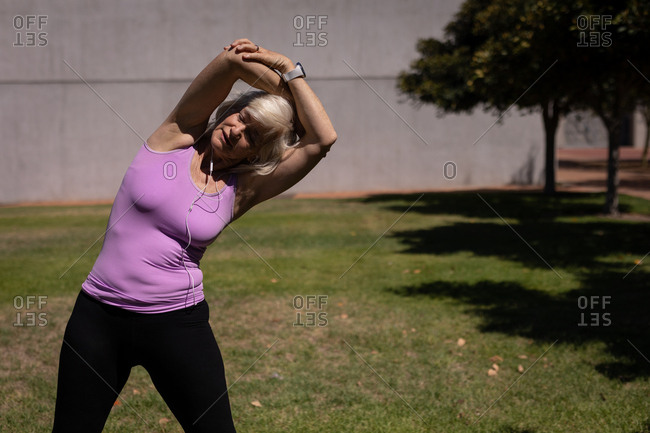 Active senior woman exercising in the park