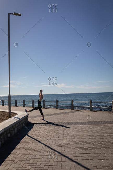 Active senior woman exercising on a promenade