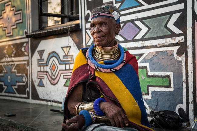 South Africa - November 7, 2017: Portrait of a senior Ndebele woman wearing colorful traditional clothing