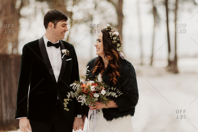 Bride and groom walking in winter setting