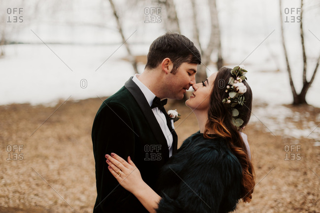 Bride and groom kissing in winter setting