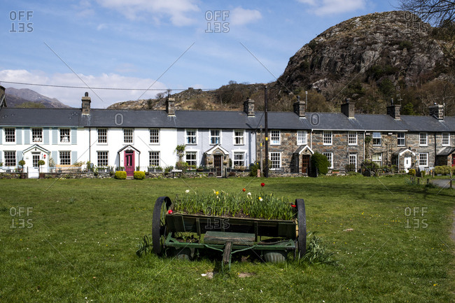 Houses and flowers along a main road near a slate quarry in Blaenau Ffestiniog, a historic mining town in North Wales, United Kingdom