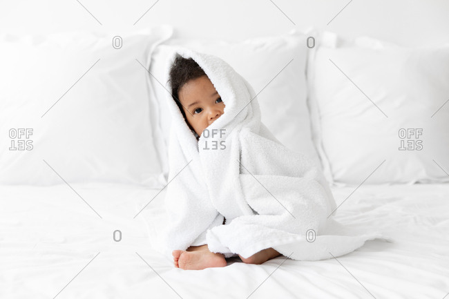 Black baby wrapped in towel after bath