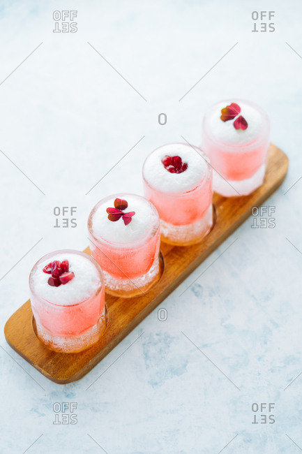 Pink cocktails on a flight board