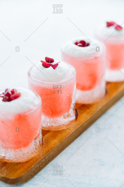 Close up of pink cocktails on a flight board