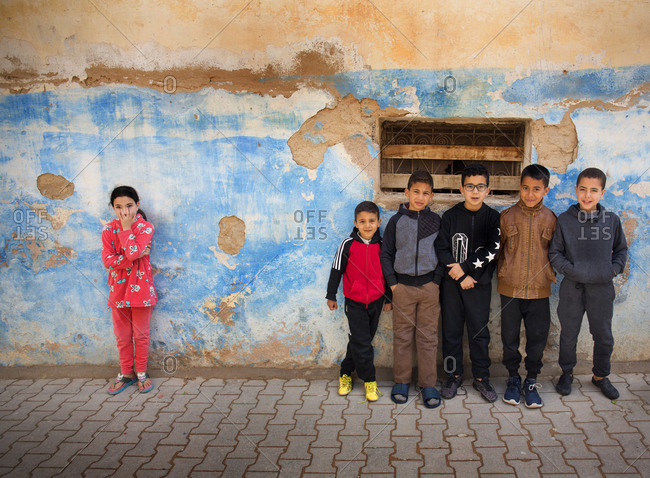 Fes, Morocco - April 6, 2019: Portrait of a group of young kids on a backstreet of old town