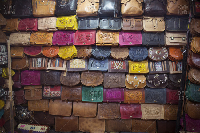 Fes, Morocco - April 6, 2019: Freshly made leather purses on display for sale for tourists to buy