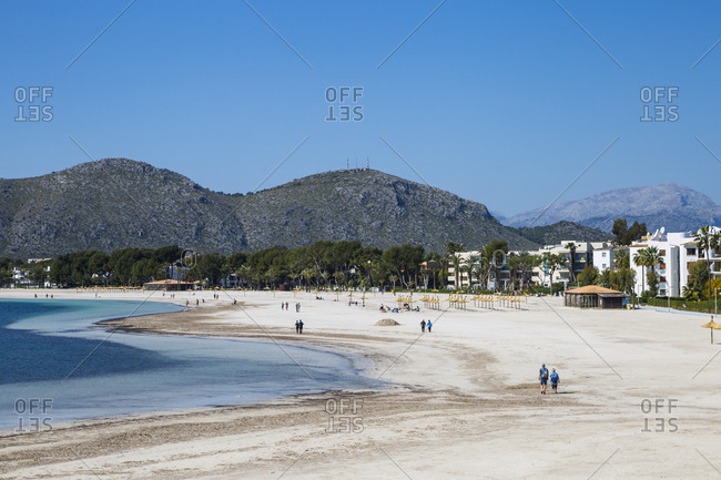 March 25, 2019: Tourists on the beach in Port d'Alcudia, Mallorca, Spain.Tourists on the beach in Port d'Alcudia, Mallorca, Spain.