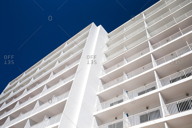 The front of a large hotel with balconies in Port d'Alcudia, Mallorca, Spain.