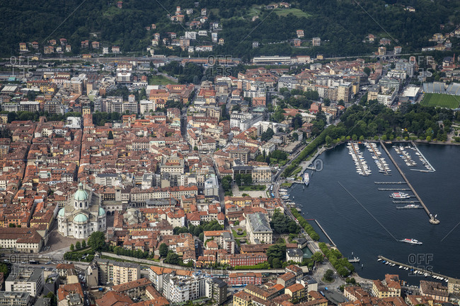 An aerial view of Lake Como and the Como Cathedral, shot from Brunate in Lombardy, Italy.