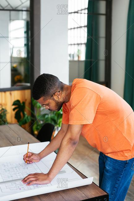 Young designer working in studio.
