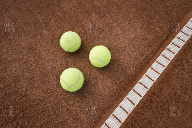 Tennis balls on playing field, Bavaria, Germany