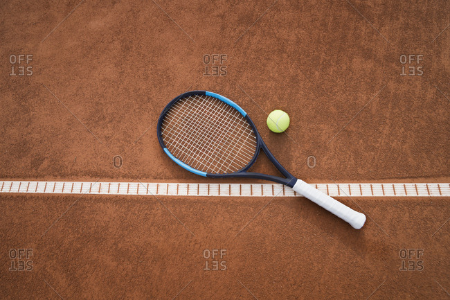 Tennis ball with racket on tennis court, Bavaria, Germany