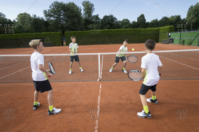Young boys playing tennis, Bavaria, Germany