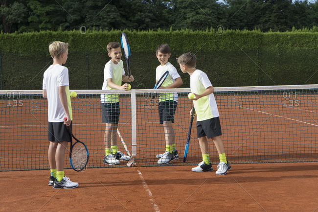 Young boys playing tennis on a sunny day, Bavaria, Germany