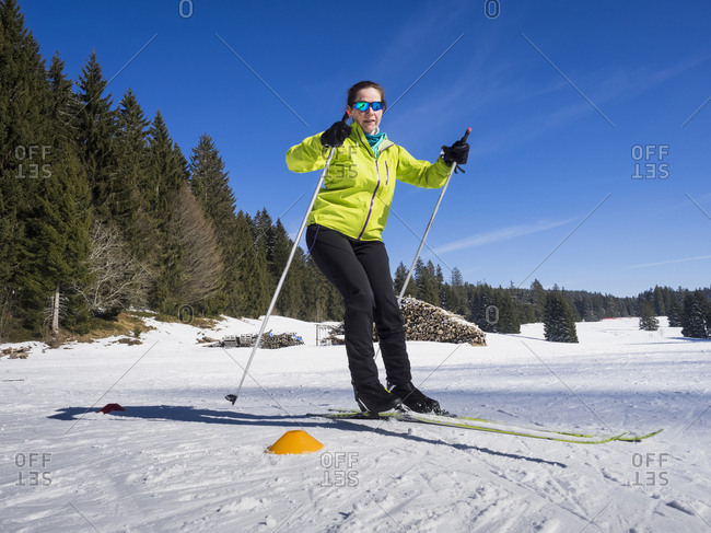 Young woman learning cross country skiing course, Black-Forest, Baden-Wurttemberg, Germany