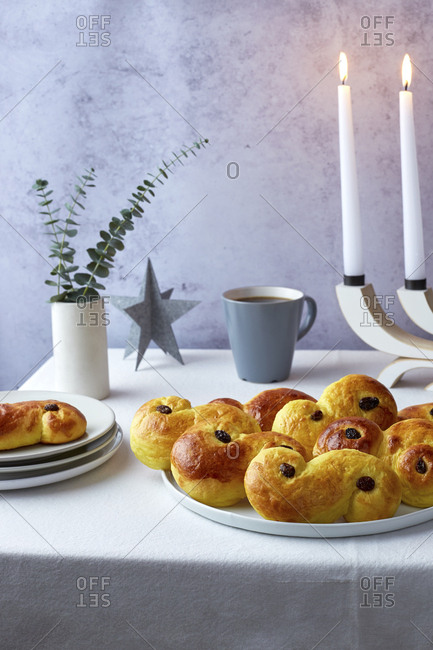 Plate of Swedish Saffron Buns with Coffee and Candles