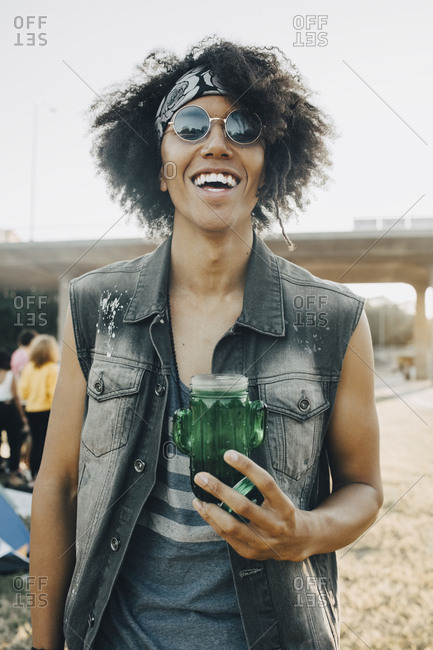 Portrait of smiling young man with jar in music event