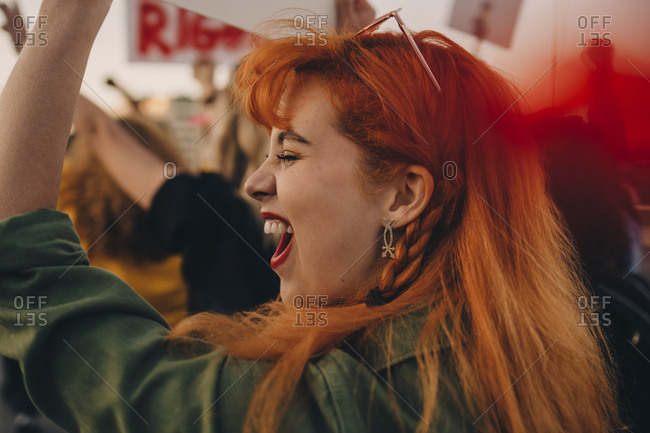 Close-up of young woman shouting while protesting for rights