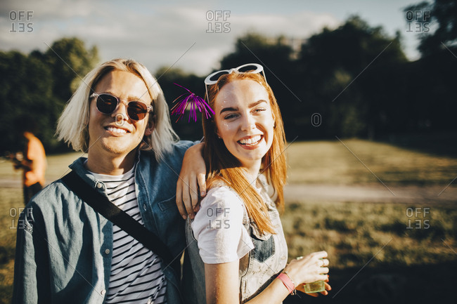 Portrait of smiling male and female friends at concert