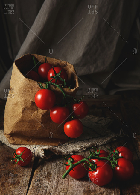 Paper bag and bright red tomatoes