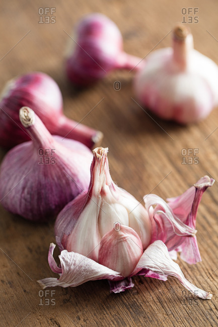 Whole garlic on wooden surface