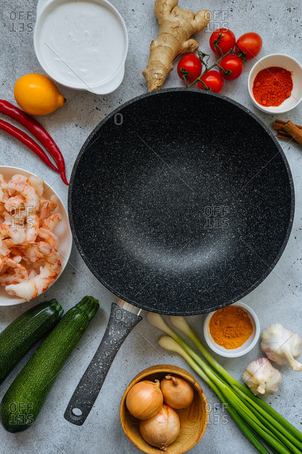 Shrimp curry ingredients and frying pan