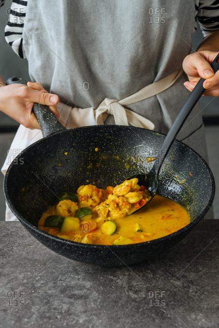 Chef preparing shrimp curry