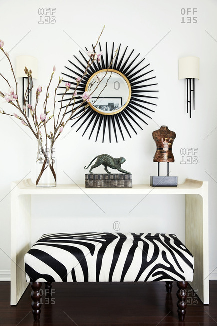 Los Angeles, CA - March 28, 2019: Zebra bench by console table