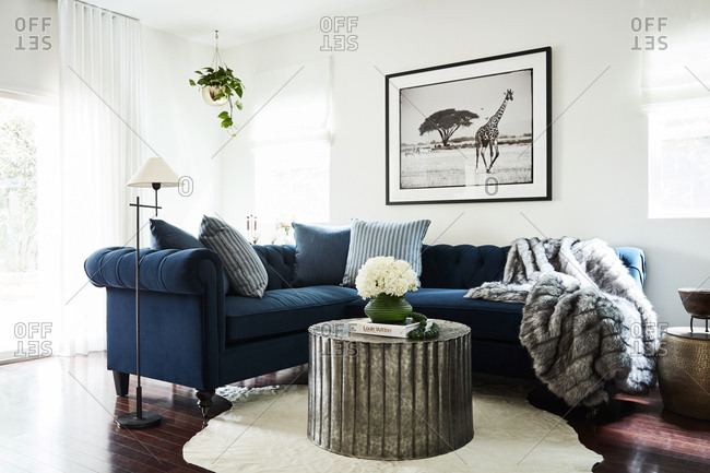 Los Angeles, CA - March 28, 2019: Blue sectional in an upscale home