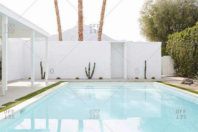 February 26, 2019: Blue swimming pool in a backyard of a luxury home