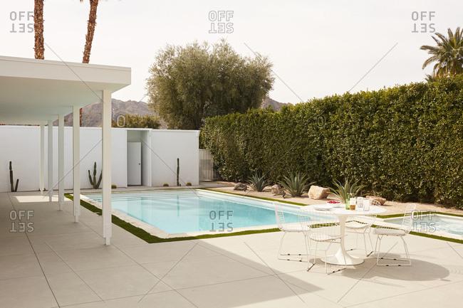 Indian Wells, CA - February 26, 2019: Swimming pool in a backyard of a luxury home