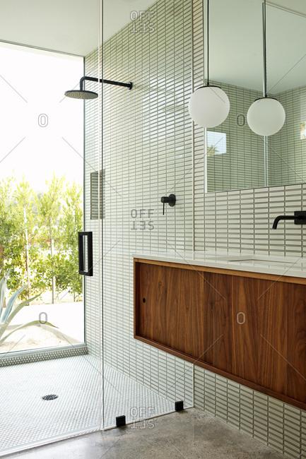 Modern bathroom with glass shower walls