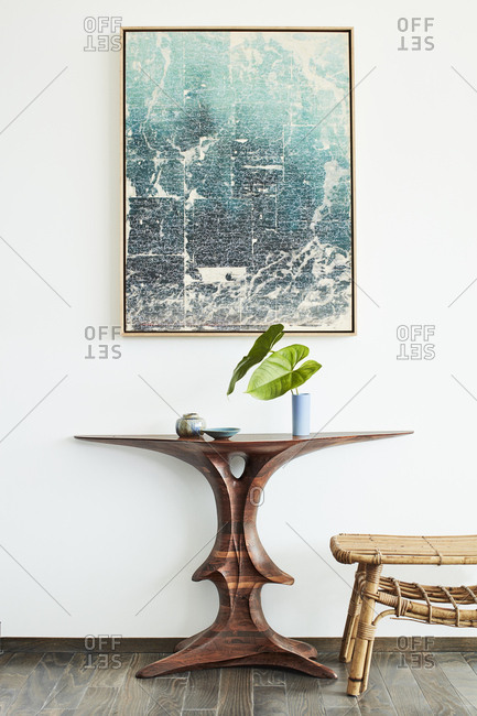 Los Angeles, CA - January 1, 2016: Artwork over wooden side table