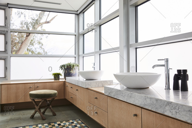 Modern bathroom with bright windows
